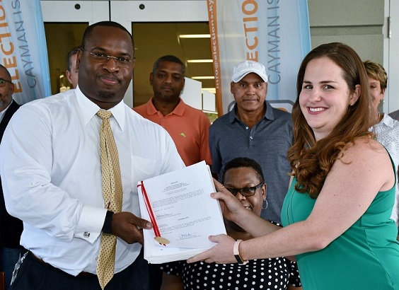 Elections Office Supervisor, Wesley Howell, officially accept the People Initiated Referendum petition from Cruise Port Referendum group member, Michelle Lockwood
